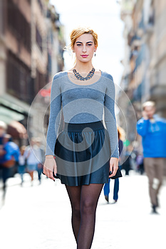 Young girl walking in the city. Youth fashion.