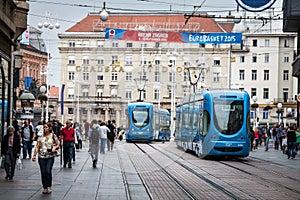 Zagreb, Croatia. Street crowd and tram