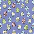 Seamless easter eggs pattern on blue background