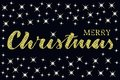 Merry christmas written quote with some sparkle stars. Glitter texture