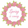 Typography banner spring is coming. Pink flower, green leaves wreath