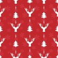 Vector seamless Christmas pattern; white holiday elements on red background.
