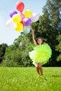 �hild with a bunch of balloons in their hands Royalty Free Stock Photos