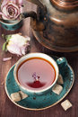 Ð¡up of tea and a vintage teapot Stock Images