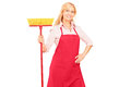 Ðœature female cleaner with brush in her hand Royalty Free Stock Image