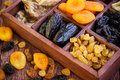 Аssorted dried fruits in wooden box Royalty Free Stock Photo