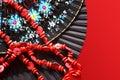 öppen fan för hand två och röda pärlor Royaltyfri Foto