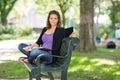 überzeugter student sitting on bench am campus Stockbild