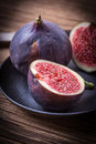 image photo : Sliced figs on a wooden table.