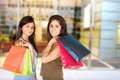 image photo : Beautiful teenagers with shopping bags