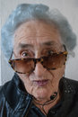 image photo : Grandmother with sunglasses, headphones and leather jacket