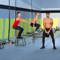 image photo : Crossfit box jump people group and kettlebell man
