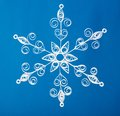 нand made paper christmas snowflake on blue background Royalty Free Stock Photos