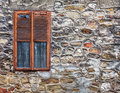 оld weathered cement wall exposing broken bricks background wit with old window Stock Photo