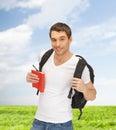 путешествовать сту ент с рюкзаком и книгой Стоковое Изображение RF