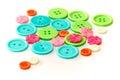 сортированные красочные кнопки на бе изной Стоковая Фотография