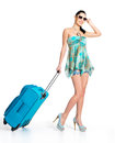 сasual woman standing with travel suitcase full length of casual isolated on white background Royalty Free Stock Photography