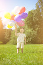 сhild with a bunch of balloons in their hands child Stock Photography