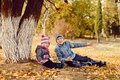 сhildren in park brother and sister having fun fall Stock Images