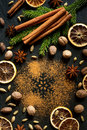сinnamon nutmeg star anise cardamom and cloves christmas spices on a dark background spruce branches Stock Photo