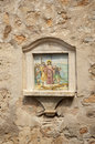 сrucifixion of the christ crucifixion ceramic tile on house wall deia spain Royalty Free Stock Image