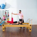 image photo : Pilates aerobic personal trainer man in cadillac