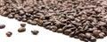 一个精密加奶咖啡杯子用咖啡豆 免版税库存照片