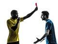 两个人显示红牌剪影的足球运动员和裁判员 库存图片