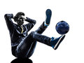 人足球自由式球员剪影 免版税图库摄影
