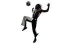 人足球运动员玩杂耍的橄榄球剪影 免版税图库摄影