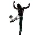人足球运动员玩杂耍的橄榄球silhouet 图库摄影