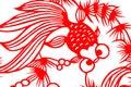 传统红色纸张剪切鱼 免版税库存图片