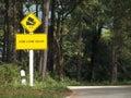 使用低速档交通标志 库存照片