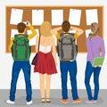 后面观点的看海报栏的大学生 图库摄影