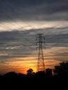 在日落的高压岗位。 图库摄影
