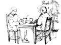 在桌上喝鸡尾酒的两个人 图库摄影