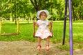 女孩一点坐的摇摆 库存照片