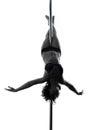 妇女杆舞蹈演员克服膝盖姿势剪影 免版税图库摄影