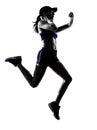 妇女赛跑者慢跑者剪影 免版税库存照片