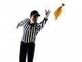 投掷 旗剪影的橄榄球裁判员 免版税库存照片