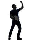 拿着数字式片剂剪影的人 免版税图库摄影