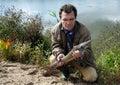 有鱼西伯利亚人的stargeon渔夫 图库摄影