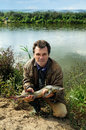 有鱼西伯利亚人的stargeon渔夫 库存照片