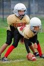 橄榄球线路并列争球青年时期 图库摄影