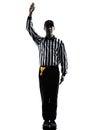 橄榄球裁判员打手势剪影 免版税库存照片