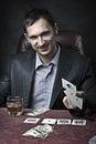 演奏啤牌赢利地区的商人 库存照片