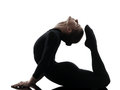 行使体操瑜伽的妇女柔术表演者剪影 免版税库存图片