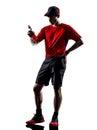 赛跑者慢跑者饮用的能量喝剪影 库存照片