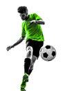 踢剪影的足球足球运动员  人 库存图片
