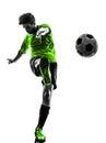 踢剪影的足球足球运动员  人 库存照片